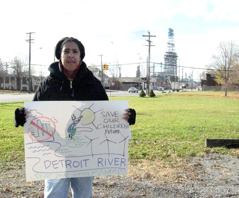 Theresa Landrum lives near the Marathon oil refinery, seen in the background.