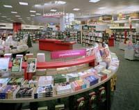 Even the fixtures within the new Borders Concept Store in Ann Arbor, Mich. have been redesigned to encourage customer exploration. Curved tables in the front of the store allow customers to move easily through the selection of spotlighted books.