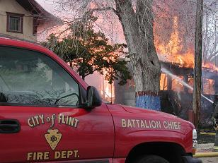 Flint firefighters reach a tentative agreement with city's emergency manager.