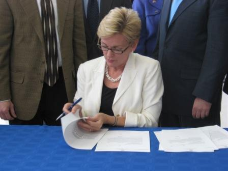 Gov. Jennifer Granholm signs the tax break bills.