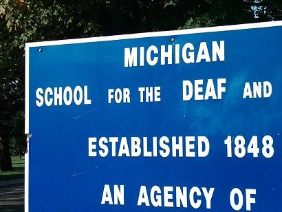 A sign at the entrance to the Michigan School for the Deaf in Flint