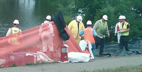 Clean up workers along the Kalamazoo River in Battle Creek in August, 2010