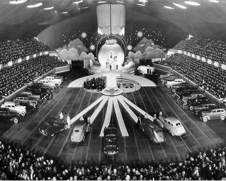 "It seems they've always been big. The Chicago Auto Show in 1938. ""Musical skits...featured the new models. In the photo is the 40-foot revolving globe."""