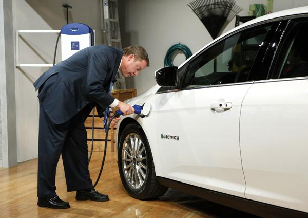 Ford Motor Company, Executive Chairman Bill Ford charges the Ford Focus Electric during the vehicle's reveal in New York City, Friday, Jan. 7, 2011.