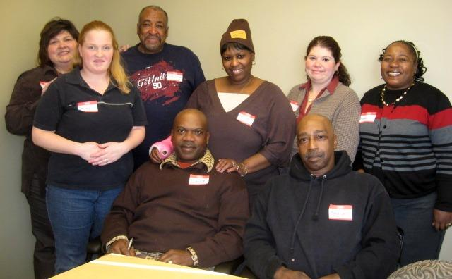Officials from Community Rebuilders with a number of people who've gone through thier programs for the homeless.