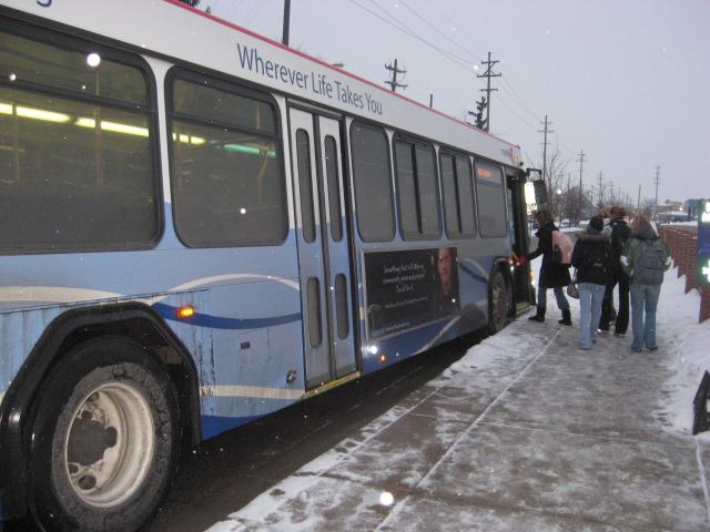 Students board The Rapid's DASH to the Hill bus.