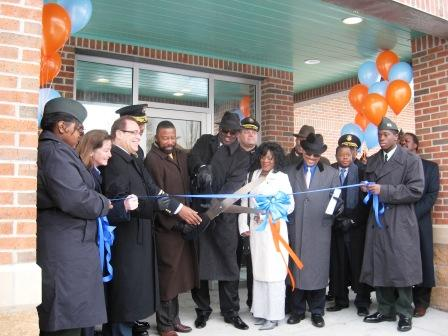 Officials including Detroit Board of Education President Anthony Adams, holding giant scissors, and Emergency Financial Manager Robert Bobb, to Adams' left, were on hand for the opening of the new DPS police headquarters