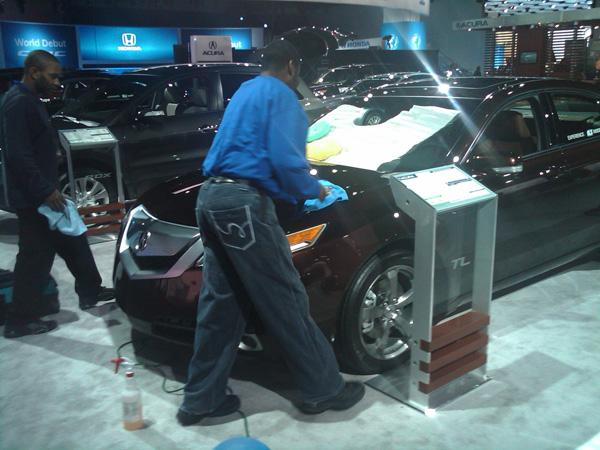 Workers getting the cars ready for display.
