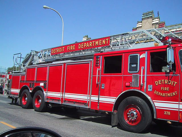 side view of a red Detroit Fire Department Firetruck.