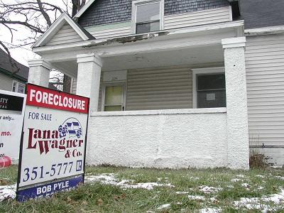 A foreclosure sign sits in front of a home in Lansing, Michigan