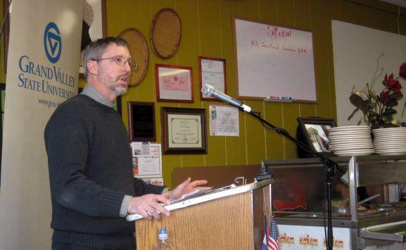 GVSU professor Peter Wampler talks about the new fund inside Chez Olga, a Haitian restaurant in Grand Rapids.