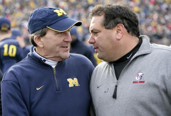 Brady Hoke (right) with former UM head football coach Lloyd Carr