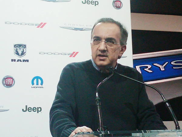 Sergio Marchionne talks with reporters at the North American International Auto Show in Detroit.