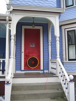 A house set up with a blower door test. Energy auditors use this device to find out where the leaks are in your home.