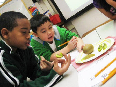 One school in Michigan is bucking the trend. English language learners come up with adjectives to describe fruit and vegetables in Marilyn Castillo's class at North Godwin Elementary School in Wyoming, Michigan.