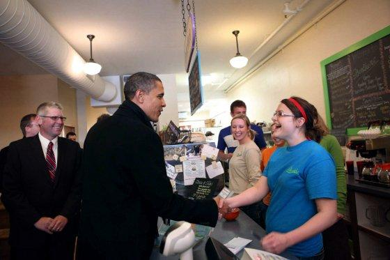 President Barack Obama greets the employees during a stop at Donkers candy store and restaurant in Marquette, Mich., February 10, 2011.
