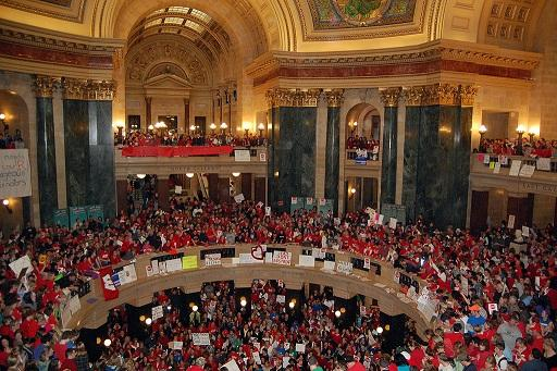 State workers and their supporters fill the Wisconsin state capitol building in Madison