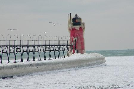 The South Haven lighthouse, covered in snow.