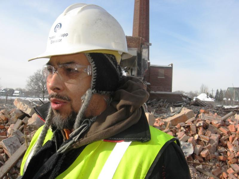 Jacob Montelongo Martinez is one of the artists salvaging brick and limestone from the demolished Munger Middle School and Chadsey High School in Southwest Detr
