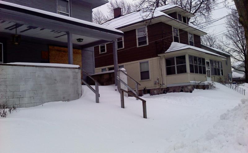 Sidewalks in front of many vacant homes in the city remain un-shoveled.