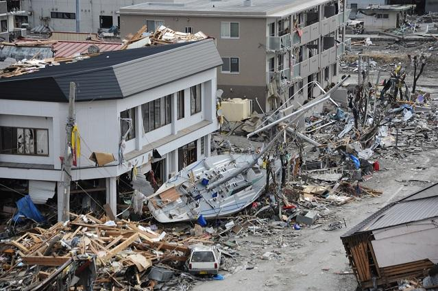 OFUNATO, Japan (March 15, 2011) - A fishing boat is noticeably out of place after being swept ashore during a massive tsunami that impacted this Japanese fishing port. The town was devastated by an 8.9-magnitude earthquake that triggered the destructive t
