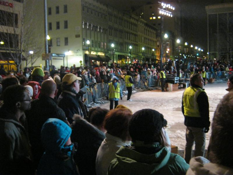 More than 1,000 people in Rosa Parks Circle brave the cold to toss or watch.