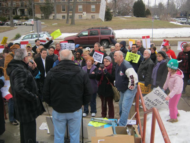 Rich Fink addresses the crowd in the Heritage Hill neighborhood Tuesday.
