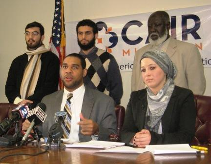 CAIR-MI Executive Director Dawud Walid, front left, is joined by staff attorney Lena Masri and (standing, left to right) Abdulrahman Cherri, Kheireddine Bouzid and Imam Ali Suliman Ali, who say they've been subjected to harassement by border guards.