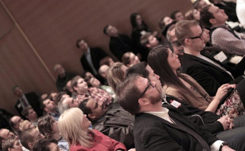 """The Grand Rapids Art Museum was packed with people checking out the first """"5x5 night""""."""