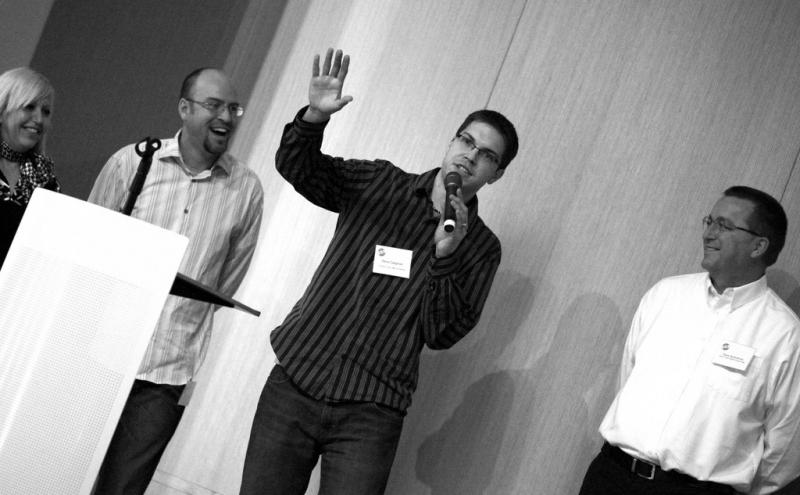 """Steve Zaagman (middle) discusses his """"upside-down-movie-night"""" with other contestants on February 22nd, 2011."""