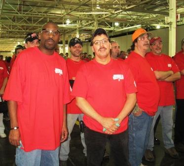 Ford asembly line workers Jerome Harris Sr., left, and Bille Rowe were among those who wore red T-shirts in solidarity with other Midwest union members.
