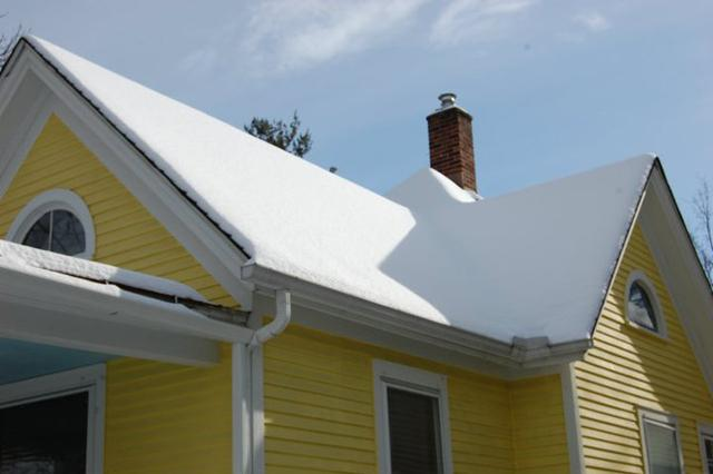 An attic insulated and sealed with open cell spray foam. The snow is picture perfect and three days after a snow fall is experiencing virtually no melting.