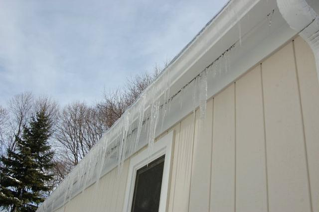 Ice dams can cause damage to the rain gutters and possibly the roof.