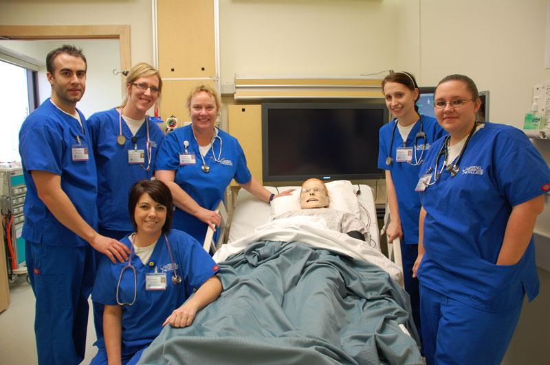 Second year nursing students Travis Pierce, Shelby Feldpausch, Staci Pierson (kneeling), Jennifer Meaton, Ashley Neybert and Jamie Hill. And of course, Mr. Pointer, center.