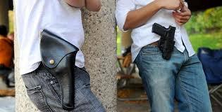 An Ingham County judge says Capital Area District Library patrons may not openly carry weapons in the facility.
