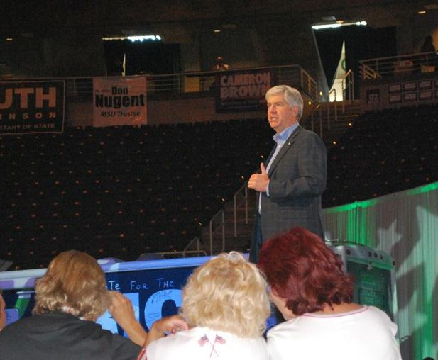 "Rick Snyder talked about reinventing Michigan on the campaign trail (Snyder at the Republican Convention in 2010). Now, Governor Snyder says he's creating a ""level playing field that encourages economic growth"" with his budget proposal."