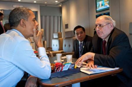 Senator Levin talks with President Obama on board Air Force One during a recent trip to Marquette