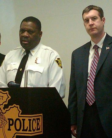 Flint Public Safety Director Alvern Lock (left) addresses the news media while Mayor Dayne Walling looks on