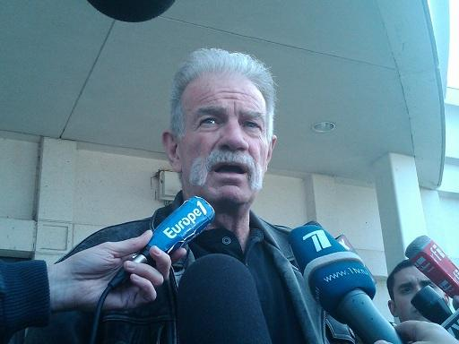 Pastor Terry Jones speaks to reporters outside the Dearborn police station