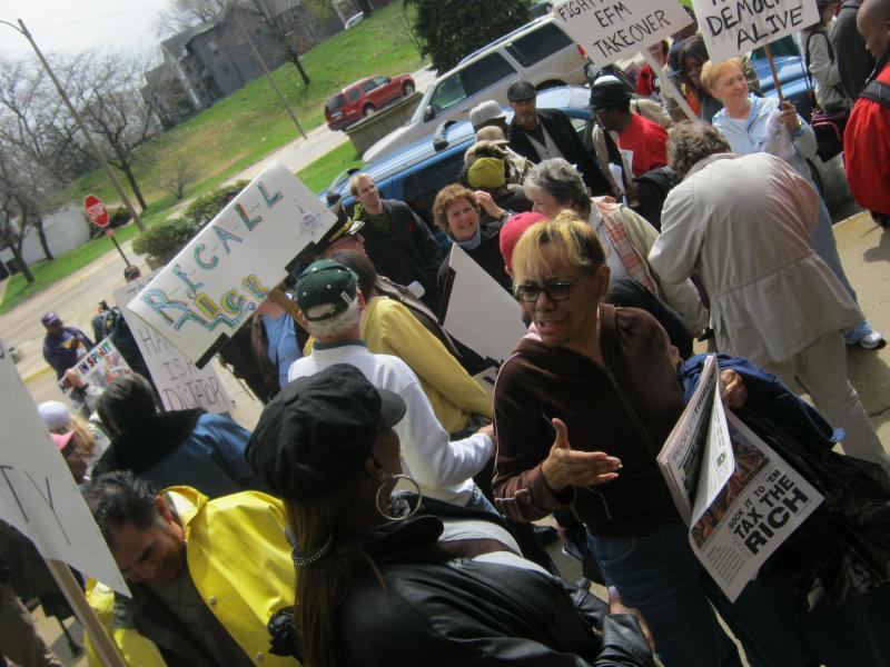 Protestors gather outside the Benton Harbor Library.