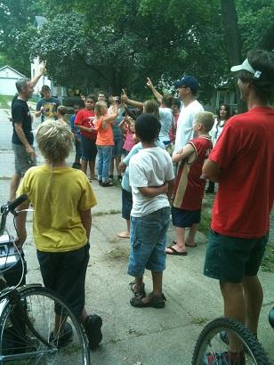 Ethan Alexander (far left) of the Open Roads Bike program speaks to a group of kids in Kalamazoo