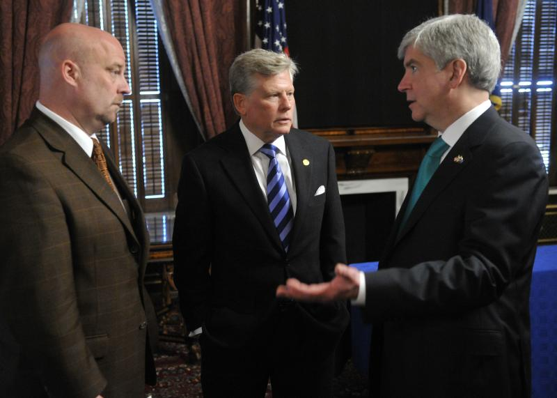 Michigan State Representatives Pscholka (left) speaks with Rep. Mark Ouimet (center) and Gov. Rick Snyder.