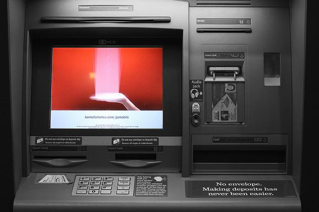 The law says banks have to post how much they plan to charge you on their ATM machines.