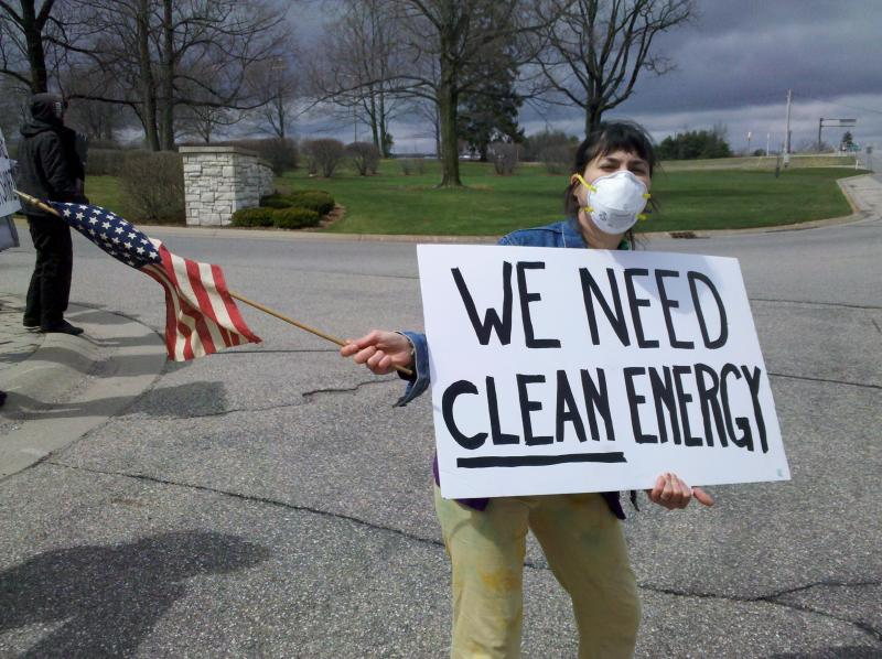 WMU student Olivia Rappel protests the energy forum in Kalamazoo.