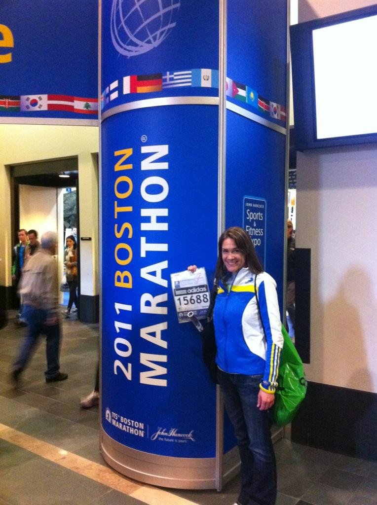 Christina picking up her bib number at the Boston Marathon