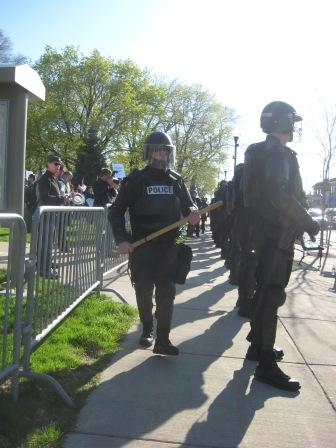 Riot police were called in to force the crowd back.