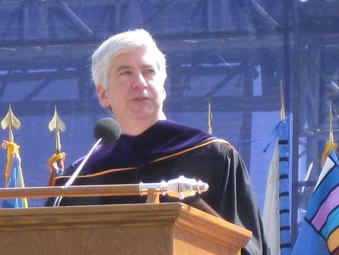 Gov. Rick Snyder tells graduating University of Michigan students its important to continue exploring as they move into the next phase of their lives.   The governor didn't mention his proposal to trim state funding of higher education by 15%.