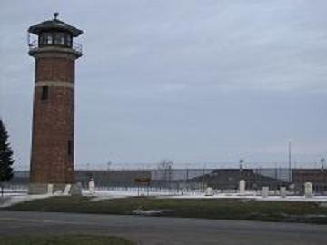 A guard tower stands overlooking the yard at one of the state prisons in Jackson