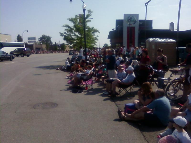 People line Michigan Avenue in Dearborn for the city's Memorial Day parade.