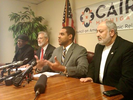 Dawud Walid of the Council on American Islamic Relations is flanked by Detroit area imams at a news conference in Southfield.